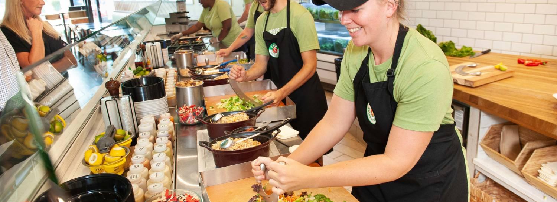 Crew at Chop 5 Salad Kitchen Making Fresh Salads